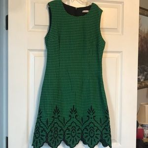 Cute dress green and black with appliqué on bottom